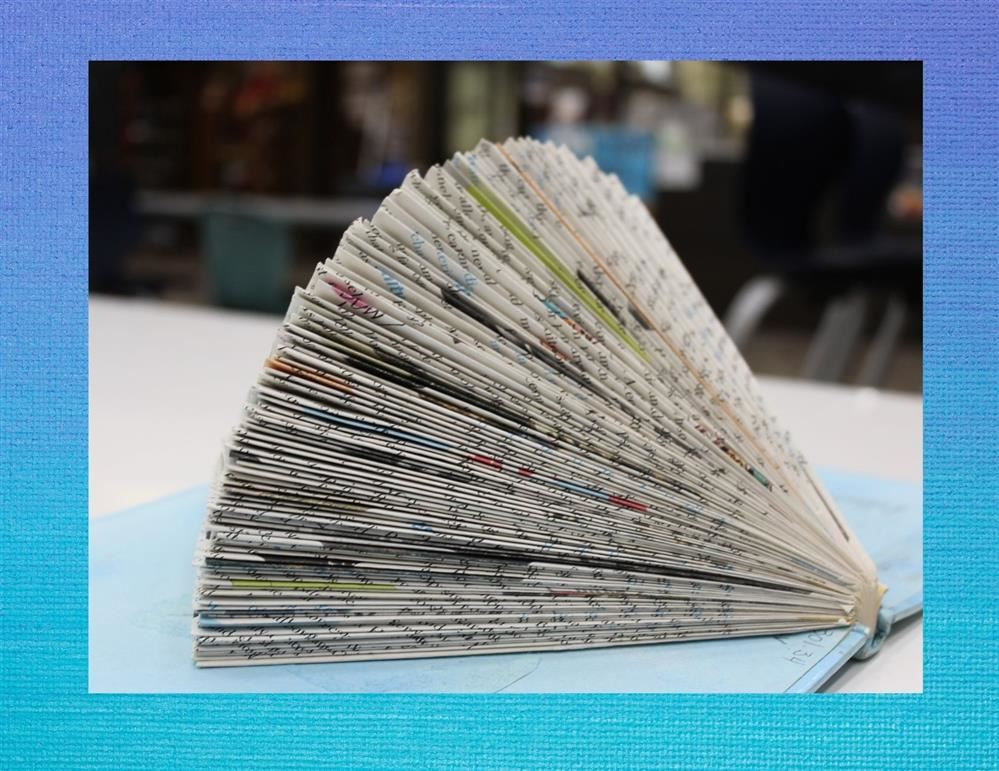 Book that has been used to create art work by folding the pages.